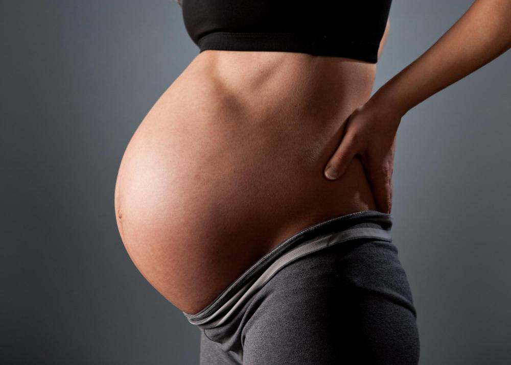 pregnant woman before prenatal chiropractic care in Beaverton